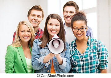 group of students with megaphone at school - education...