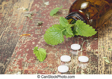Lemon Balm. Bottle with tablets and