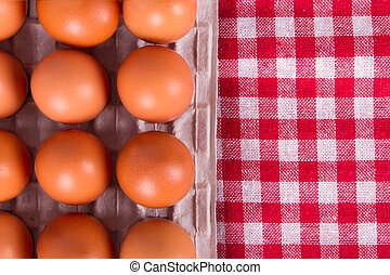 Eggs on Table Cloth - Top view of eggs on dinner table...