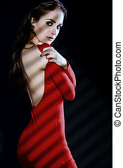 desirable - Fashion shot of a sexual woman in elegant red...