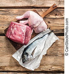 fresh raw meat products on wooden table