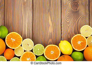 Citrus fruits. Oranges, limes and lemons. Top view over...