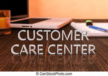 Customer Care Center - letters on wooden desk with laptop...