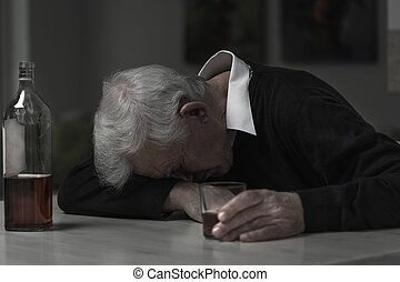 Old man alcoholic - Old retired man alcoholic sleeping on...