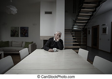 Loneliness in a big house - Old man lonely in a big empty...