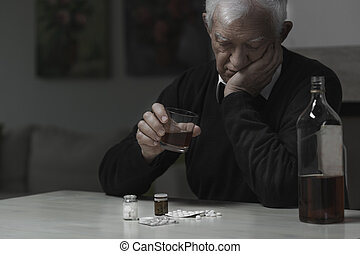 Elderly man addicted to alcohol and drugs