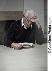 Lonely man eating soup - Old aged and lonely man eating soup