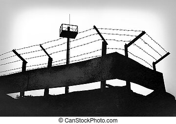 Prison walls with barbed wire - Prison fence with barbed...