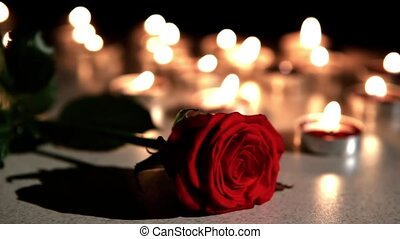 Romantic atmosphere : extinguished candles with rose -...