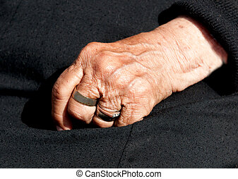 Senior Womans aged hand - Senior woman's aged hand with...