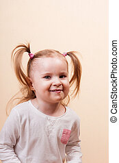 Tricky Girl - Portrait of a cute little tricky girl, studio...