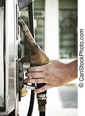 Fuel Pump - Man hand holding fuel pump