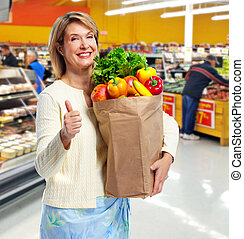 Shopping woman. - Senior shopping woman with grocery items....