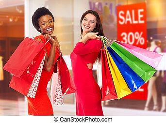 Shopping women. - Beautiful women with shopping bags in shop
