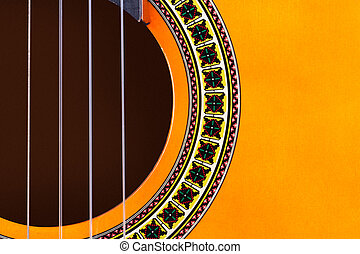 Acoustic Guitar - Detail view of yellow wooden classical...