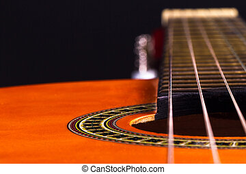 Acoustic Guitar - Perspective view of orange wooden...