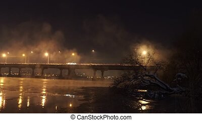 Winter time, night and the river with bridge - The river and...