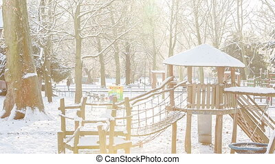 playground on snowy day - snow covered playground in park