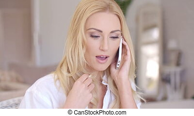 Smiling Blond Female Talking through Phone