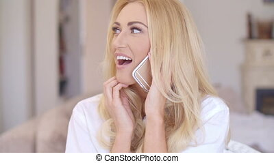Happy Blond Woman Talking Though Phone - Close up Happy...