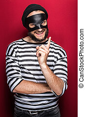 criminal, thief, robber, crime - Crafty bandit smiling and...