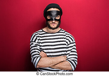 criminal, thief, robber, crime - Angry thief with mask on...