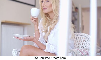 Happy Blond Woman in White Drinking Coffee - Close up Happy...
