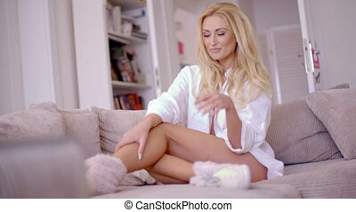 Flirty Woman Leaning on the Living Room Sofa - Pretty Flirty...