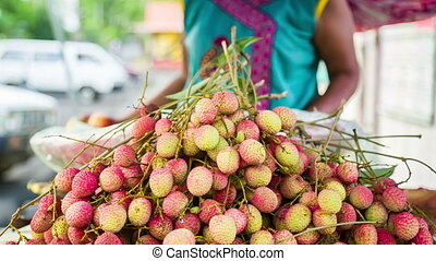 selling lychees on street in mauritius - tasty lychees at...