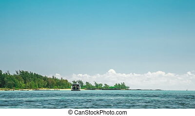 sailing with motorboat to Ile aux Cerfs in mauritius