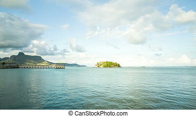 mauritian seaside with old pier in mahebourg - sundown at...
