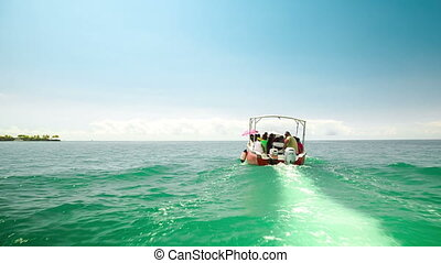 taxi boat ride with passengers in mauritius - following a...