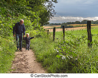 grandfather walking with grandchild - grandfather is walking...