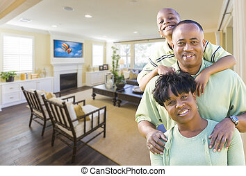 African Amercian Family In Living Room - Happy Young African...