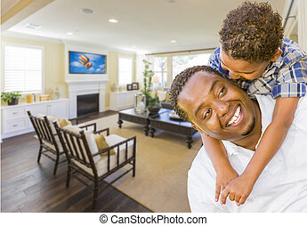 Afrian American Father and Mixed Race Son in Living Room