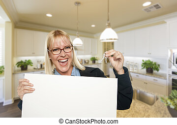 Young Woman Holding Blank Sign and Keys Inside Kitchen