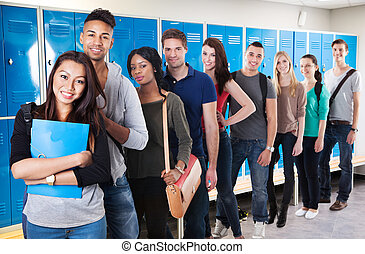 Multiethnic College Students Standing In A Row - Group Of...