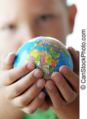World in childrens hand - The World in the hands of our...