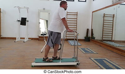 fitness - overweight man running on treadmill - fitness -...