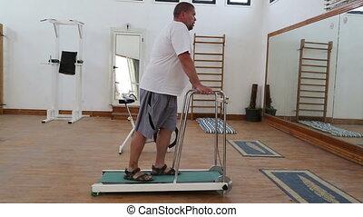 fitness - overweight man running on treadmill
