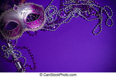 Purple Mardi-Gras or Venetian mask on purple background - A...