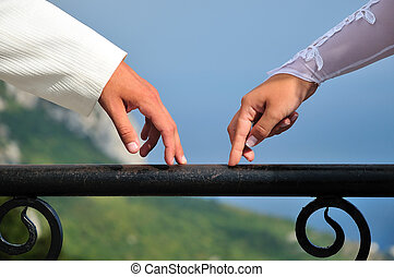 hands of bride and groom - fingers of bride and groom going...