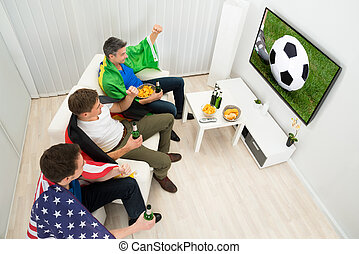 Friends Of Different Nations Watching Football Match - Group...