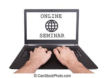 Man working on laptop, online seminar