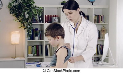 Female doctor visiting boy - Happy healthy child smiling to...