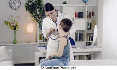 Female doctor play with boy