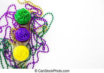 Cupcakes decorated with bright color icing for Mardi Gras...