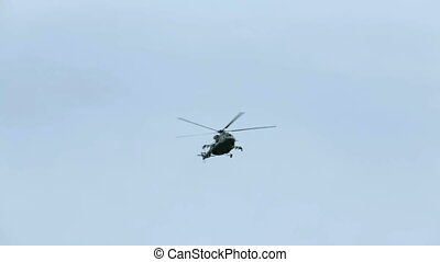 One helicopter flying in the sky during military parade -...