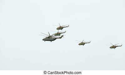 Helicopters are flying in the sky during military parade. -...