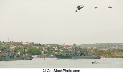 Helicopters flying in the sky during military parade Russian...